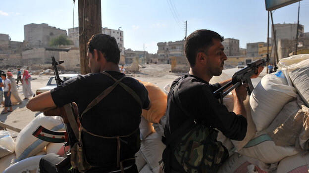 Tuesday in Aleppo, these men from an anti-Assad force were on guard at a checkpoint.