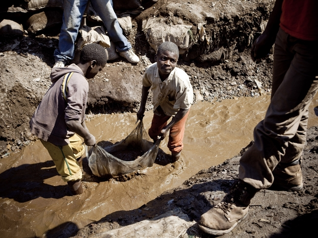 Children wash copper on July 9, 2010 at an open-air mine in Kamatanda in the rich mining province of Katanga, southeastern Democratic Republic of Congo (DRC). Forced by poverty, hundreds of students leave school to work at the mine. (AFP/Getty Images)
