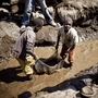 Children wash copper on July 9, 2010 at an open-air mine in Kamatanda in the rich mining province of Katanga, southeastern Democratic Republic of Congo (DRC). Forced by poverty, hundreds of students leave school to work at the mine.