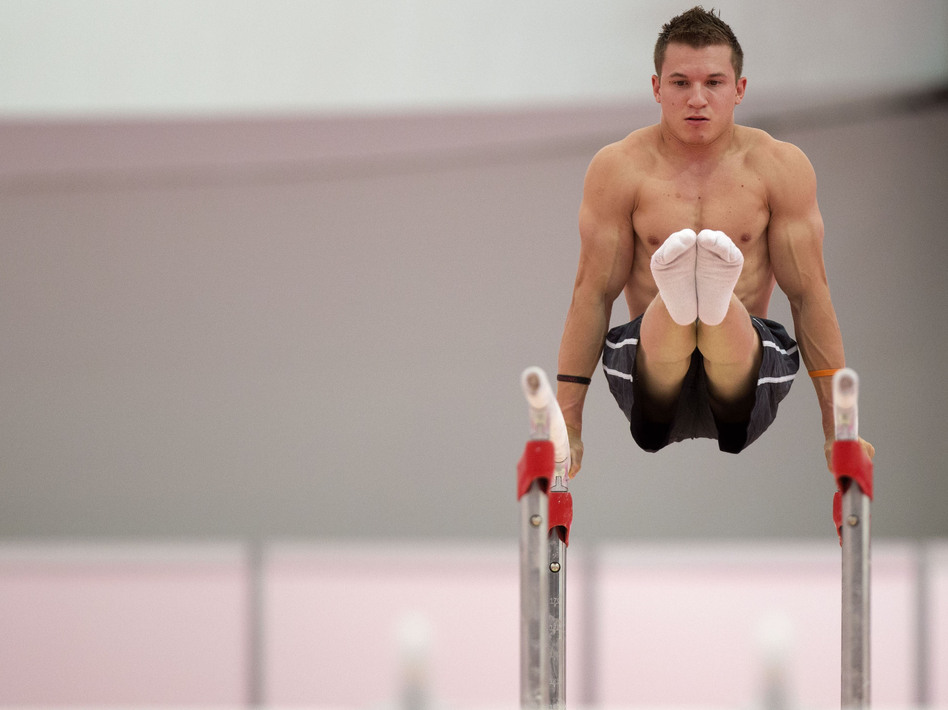 U.S. gymnast Jonathan Horton warming up on the parallel bars  in a practice arena ahead of the 2012 Summer Olympics. (AP)