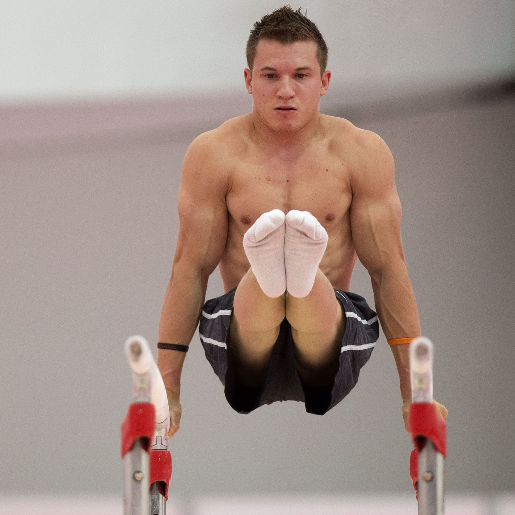 U.S. gymnast Jonathan Horton warming up on the parallel bars  in a practice arena ahead of the 2012 Summer Olympics.