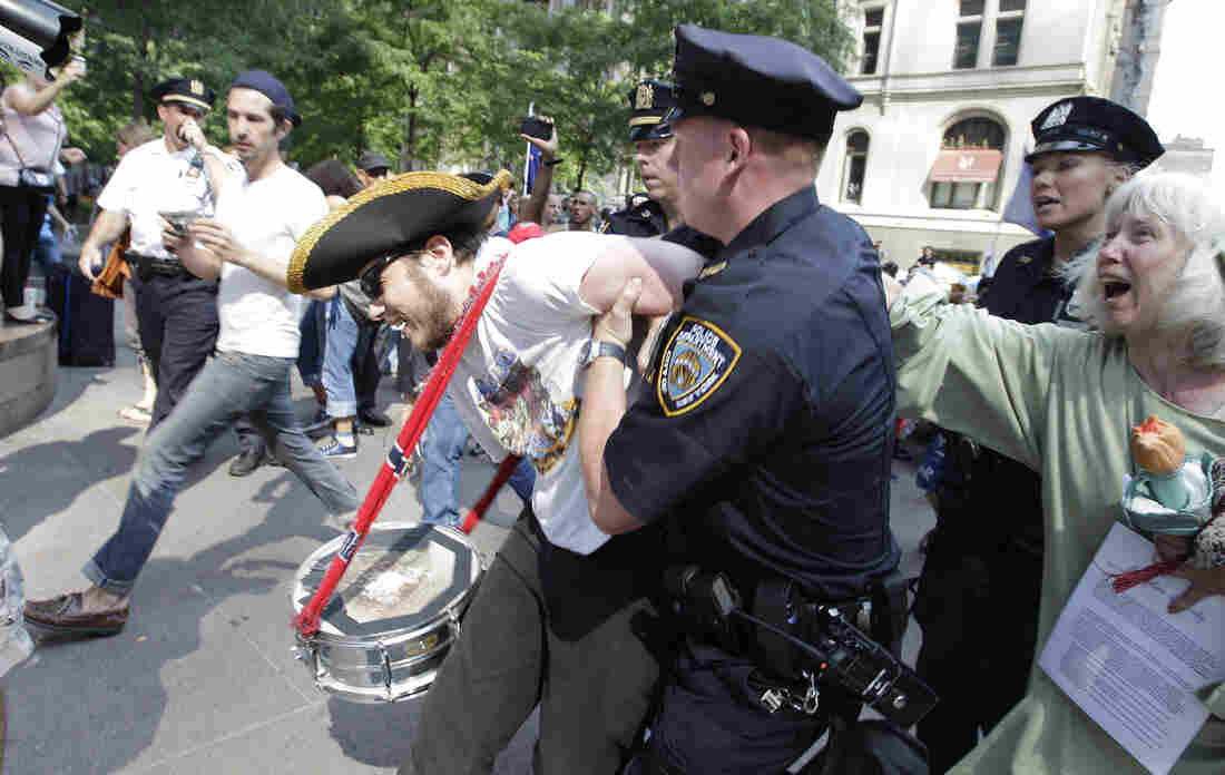 An Occupy Wall Street protestor is arrested in Zuccotti Park July 11, 2012, in New York.