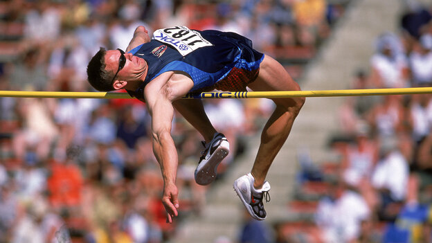 Nathan Leeper of the United States jumps during the IAAF World Championships in this photo from 2001.