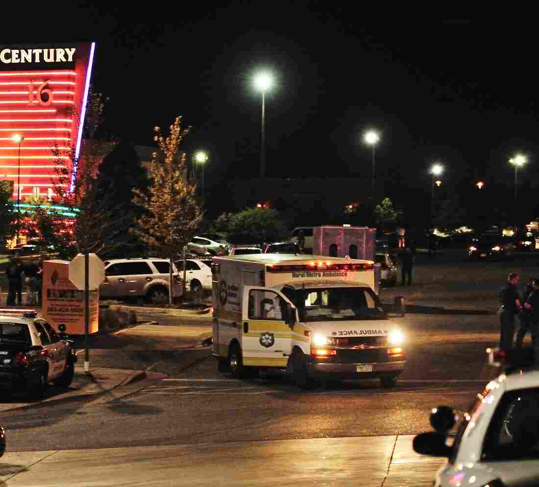 An ambulance and police cars outside the Century 16 movie theater complex in Aurora, Colo, during the early hours of July 20, 2012. A gunman attacked an audience there — killing 12 people and wounding 58.