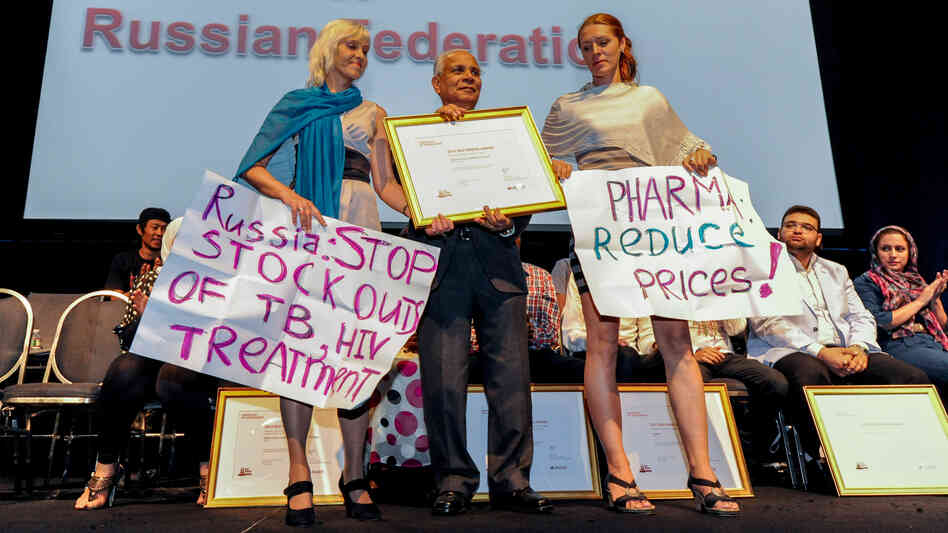 Activist Alexandra Volgina (right) accepts the Red Ribbon Award at the 19th International AIDS Conference for her grassroots group Patients in Control, which has worked to improve HIV treatment progra