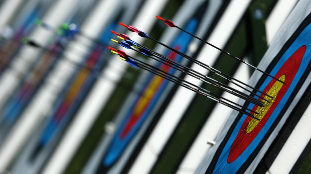 Inspired by the movie Robin Hood, Olympic sound man Dennis Baxter places microphones along the path to the target to capture the sound of arrows in flight. (Getty Images)