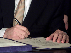 President George W. Bush signs tax cut legislation on June 7, 2001. The cuts from this and a subsequent bill are set to expire at the end of 2012.