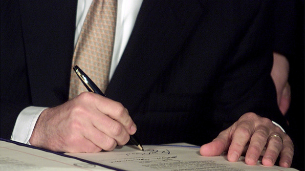 President George W. Bush signs tax cut legislation on June 7, 2001. The cuts from this and a subsequent bill are set to expire at the end of 2012. (AFP/Getty Images)