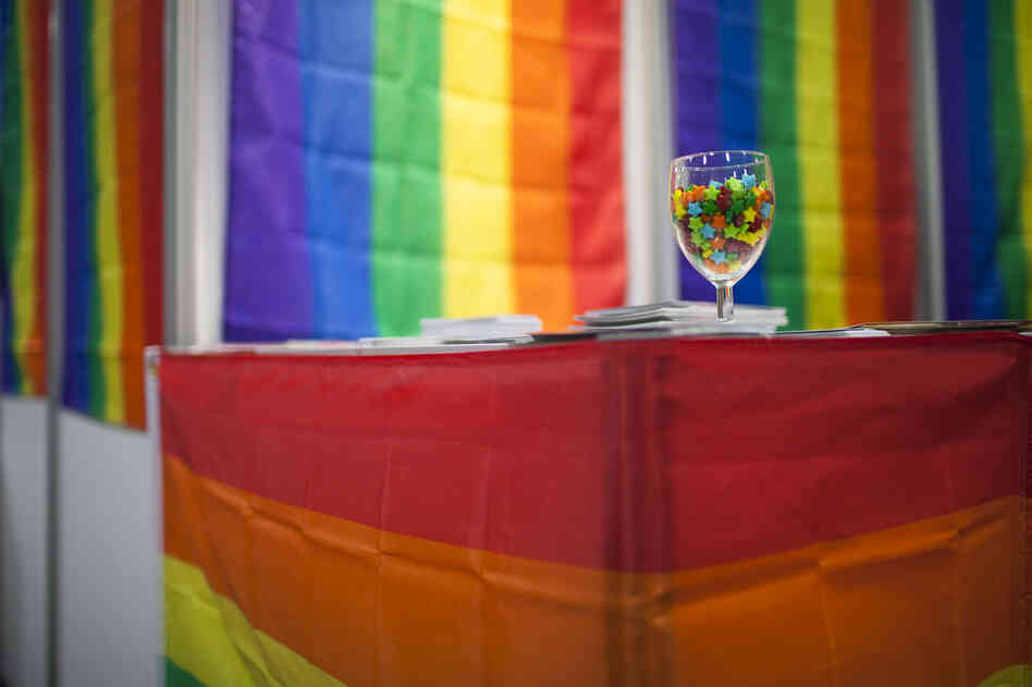 Colorful flags and candies decorate the LGBT Networking Zone. More than 120 groups from around the world set up booths in the Global Village to distribute information about the AIDS epidemic.