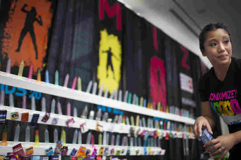 """""""You've been condomized!"""" said Joy Lynn Alegarbes, of The Condom Project, which promoted safe sex at the 19th International AIDS Conference. The group handed out more than 850,000 condoms this week."""