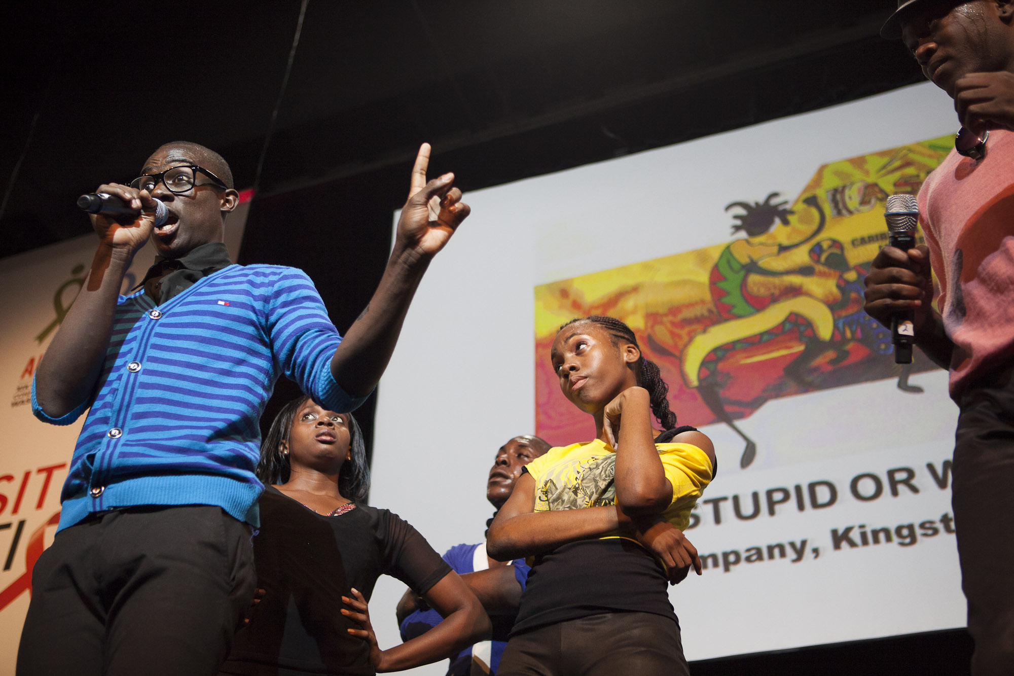 Safe, Stupid or What? The Ashe Performing Arts Company, based in Kingston, Jamaica, performed a musical television game on Thursday in the Global Village. The show used song and dance to explain how HIV is transmitted.