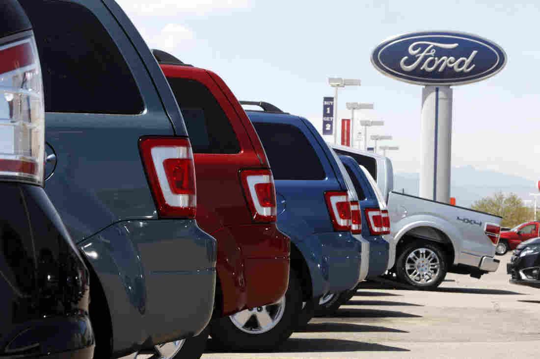 Ford Escapes sit at a Ford dealership in east Denver.
