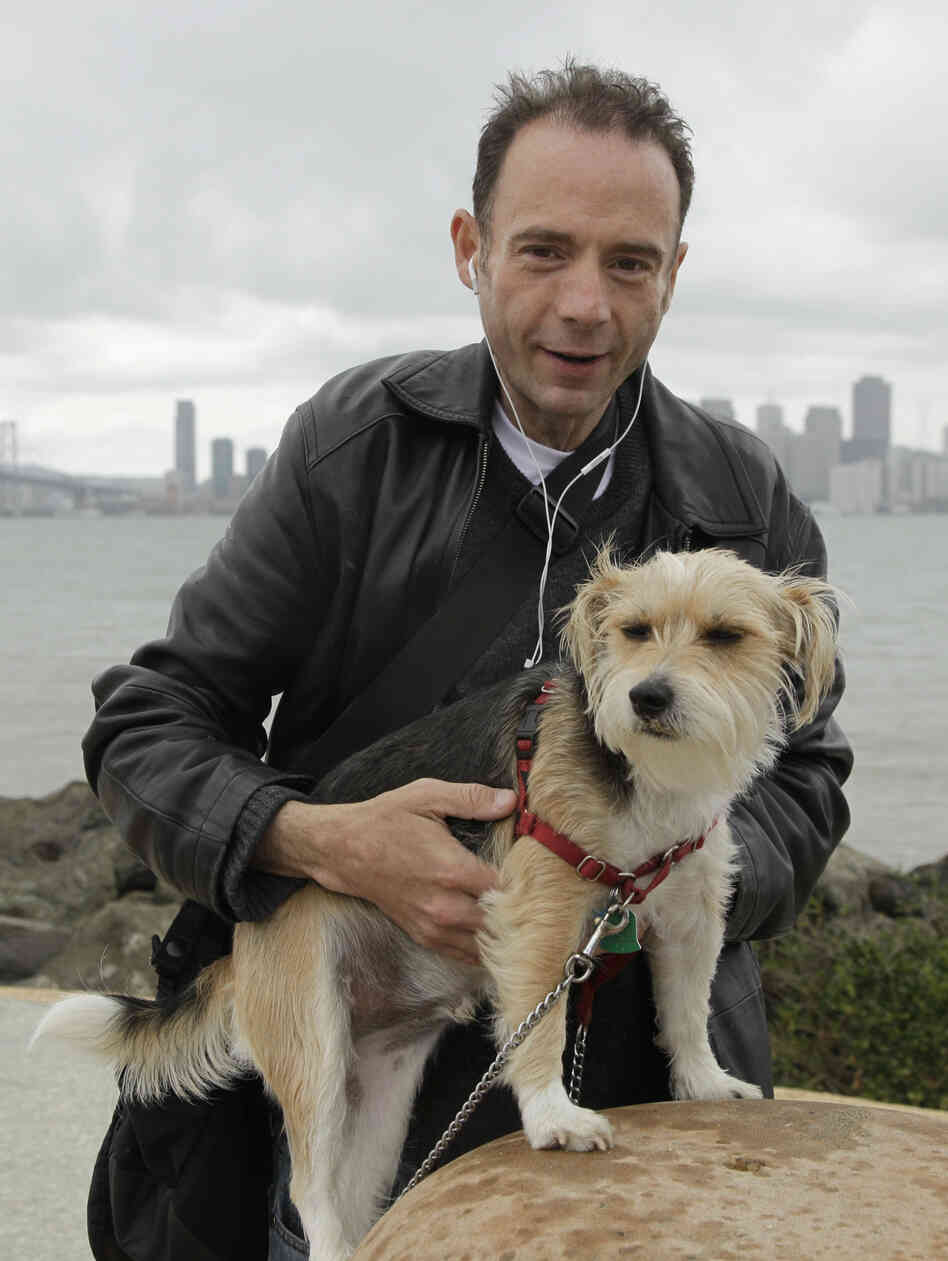 "Timothy Ray Brown, shown in May 2011 with his dog Jack in San Francisco, is the only man ever known to have been fully cured from AIDS. Brown is known as the ""Berlin patient"" because he had a bone marrow transplant in a German hospital five years ago."