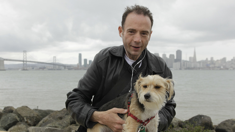 "Timothy Ray Brown, shown in May 2011 with his dog Jack in San Francisco, is the only man ever known to have been fully cured from AIDS. Brown is known as the ""Berlin patient"" because he had a bone marrow transplant in a German hospital five years ago. (AP)"