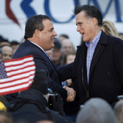 New Jersey Gov. Chris Christie greets Republican presidential candidate Mitt Romney in Des Moines, Iowa, on Dec. 30, 2011.