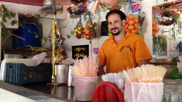 Mohamed Godb works at Paradise Juices in a Cairo suburb. One way Egyptians are trying to beat the heat this Ramadan season is breaking the fast by drinking fresh juice. (Kimberly Adams for NPR)