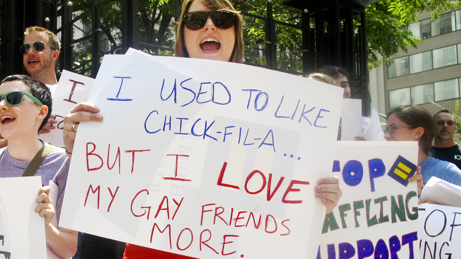 Protesters from the Human Rights Campaign chant against Chick-fil-A President Dan Cathy's anti-gay marriage stance in front of a Chick-fil-A food truck in Washington, D.C., on Thursday. (NPR)