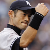 New York Yankees right fielder Ichiro Suzuki readies for a fist bump ... or a fist pump for his new song?