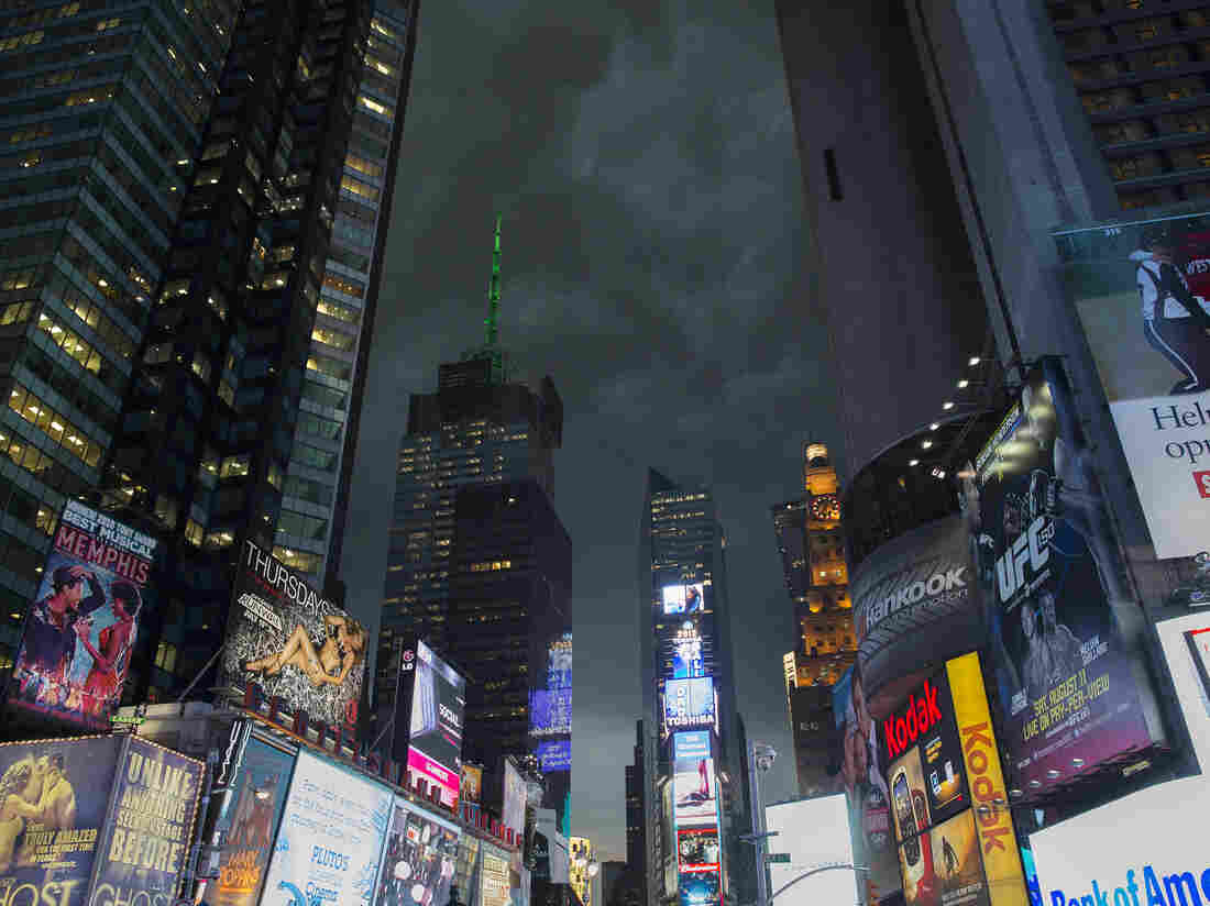 Storm clouds loom over Times Square as Manhattan braced for heavy weather Thursday in New York.
