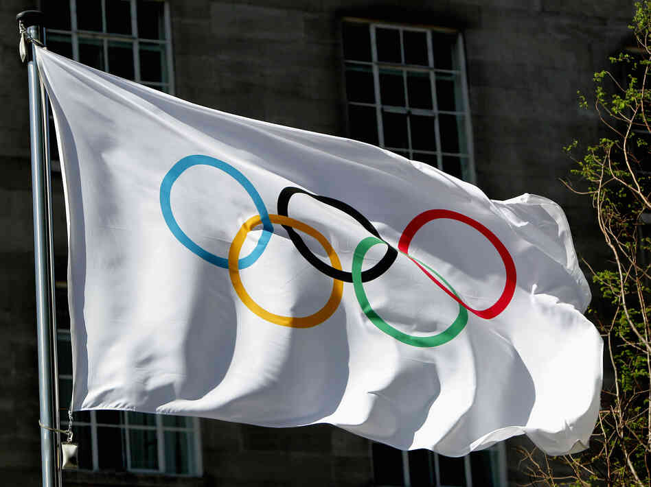 The Olympic flag waves during the International Olympic Committee meeting in London on April 6, 2011.