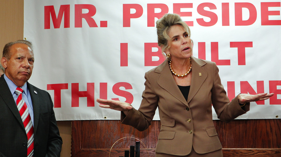 Rebecca Smith, owner of A.D. Morgan, speaks Thursday at a Tampa, Fla., event to denounce President Obama's statements about small businesses. The event was organized by the Romney campaign. At left is Lou Ramos of Value Enterprise Solutions. (Tampa Bay Times/ZUMAPRESS.com)