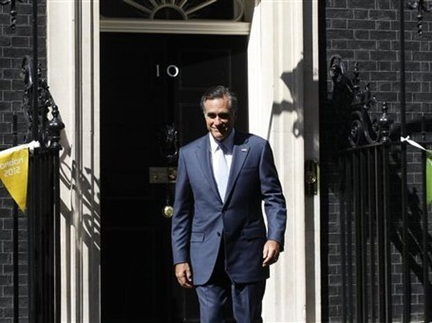Mitt Romney leaves London's 10 Downing Street after meeting with British Prime Minister David Cameron. (AP)