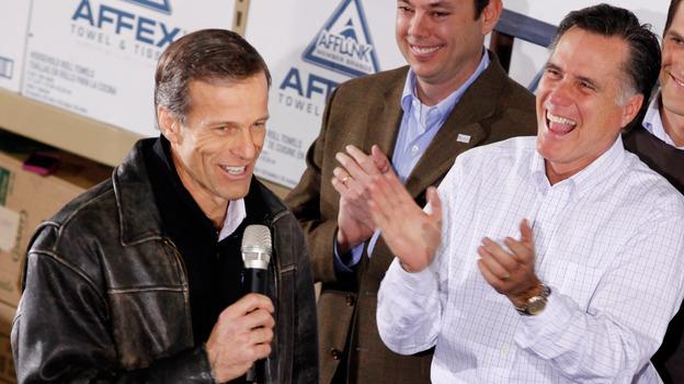 Mitt Romney gets a kick out of South Dakota Sen. John Thune's comments during a January rally in Dubuque, Iowa. (Getty Images)