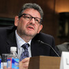 Chairman and CEO of Universal Music Group Lucian Grainge (left) and Roger Faxon, the CEO of EMI Group, testify during a Senate Judiciary subcommittee hearing on Universal's proposed merger with EMI.