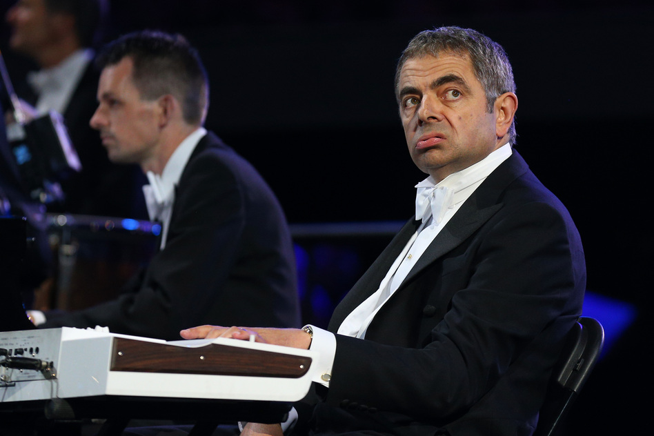 British actor Rowan Atkinson, in his role as Mr. Bean, takes part in the ceremony . (Getty Images)