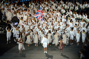 Sir Chris Hoy of the Great Britain Olympic cycling team carries his country's flag during the opening ceremony.
