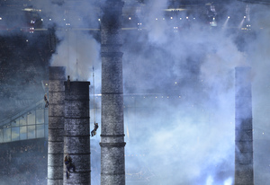 Artists climb chimneys during The Age of Industry scene of the opening ceremony.