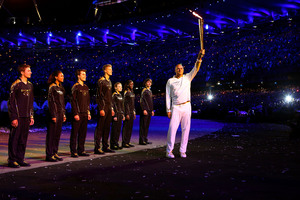 Torchbearer Sir Steve Redgrave hands the Olympic Flame over to seven young athletes who present Britain's hopes for the next Olympics.