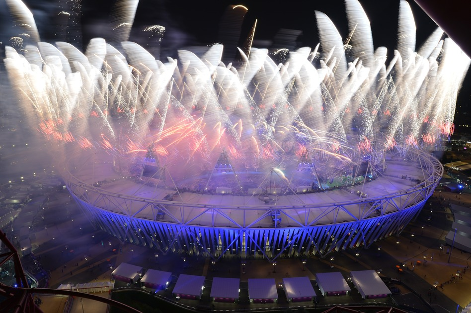 Fireworks explode from the roof of the Olympic Stadium. (AFP/Getty Images)