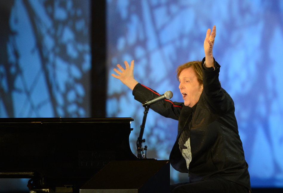 British musician Paul McCartney raises his arms as he sings at the end of the opening ceremony. (AFP/Getty Images)