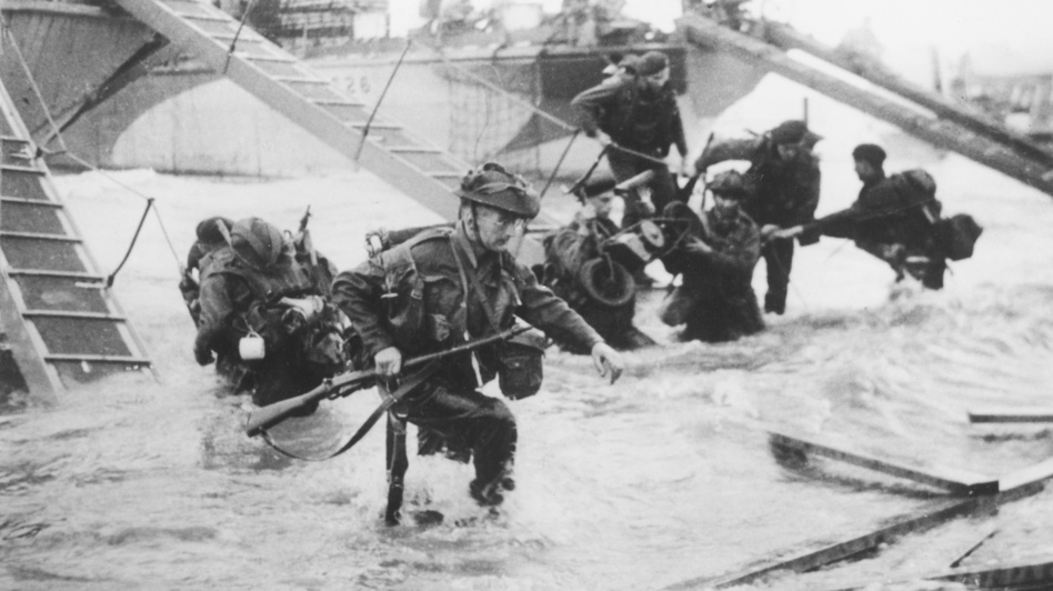 Allied troops invade Juno Beach on D-Day. Ben MacIntyre's latest book, Double Cross, recounts the grand deception beforehand that helped make the invasion a success. (Hulton Archive/Getty Images)