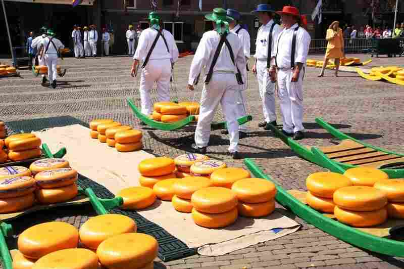 "Visitors can watch cheese being ""wheeled"" through an outdoor market at the Dutch Cheese Museum in Alkmaar, Netherlands."
