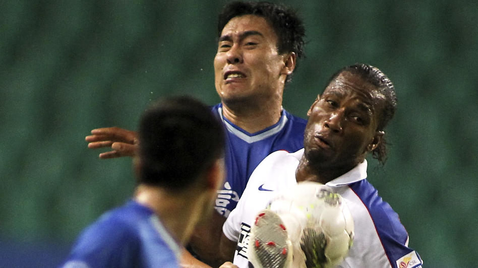 Speculation is rampant over the salary of Shanghai Shenhua's Didier Drogba, formerly with Chelsea, shown here during his Chinese Super League debut against Guangzhou Fuli in Guangzhou in southern China, July 22. (AP)