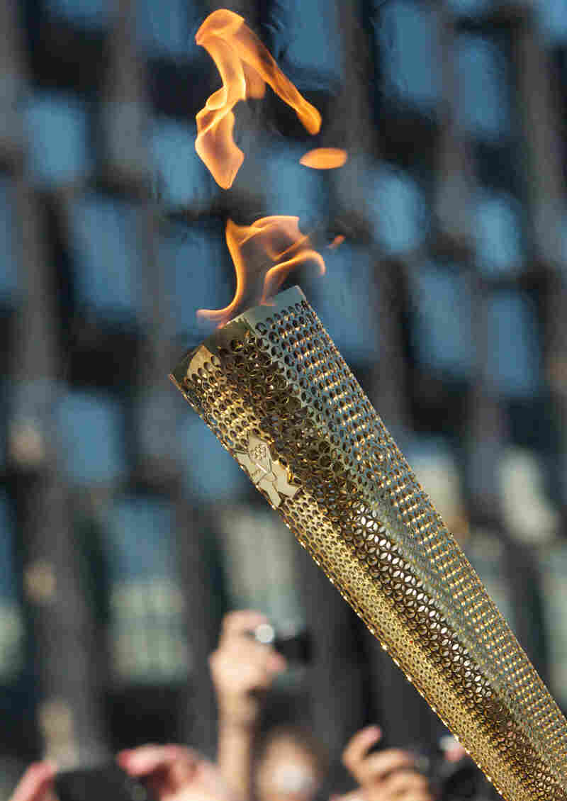 The Olympic Flame as it passed through London on Thursday.
