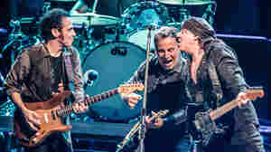 Nils Lofgren, Bruce Springsteen and Stevie Van Zandt performing in Paris earlier this month.