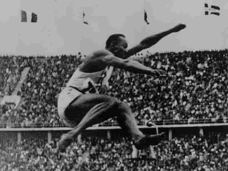Jesse Owens (1913 - 1980), who smashed so many records at the German Olympics in 1936 that Hitler refused to meet him, in the final of the long jump on August 7, 1936 in Berlin.