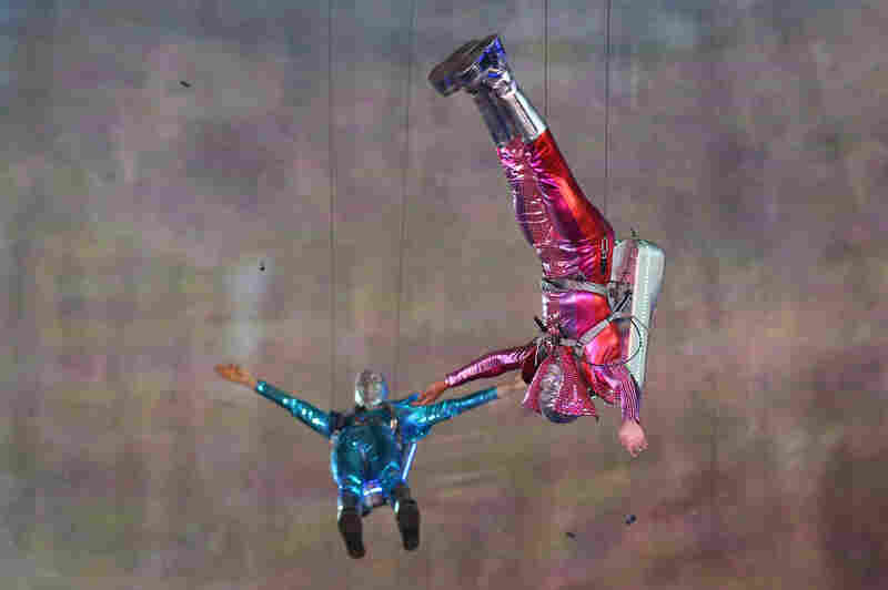 Performers with jet packs take part in the opening ceremony.