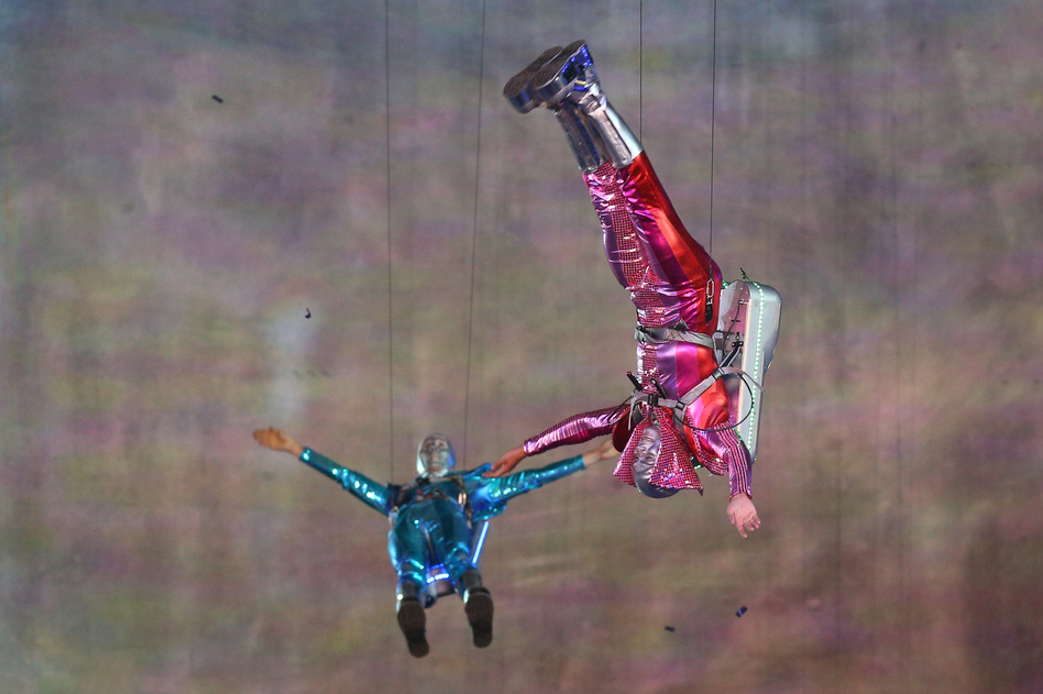 Performers with jet packs take part in the opening ceremony. (Getty Images)