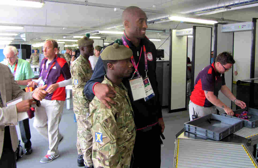 As Team USA basketball player Kobe Bryant passed through a security checkpoint Friday, British soldiers were moved to relax a ban on photography in the area.