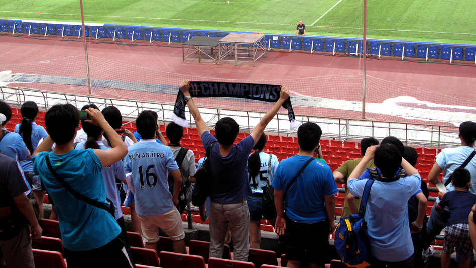 Hardcore fans were allowed to watch a Manchester City training session ahead of a match against rival Arsenal in Beijing's Bird's Nest stadium Friday. (Angie Quan for  NPR)