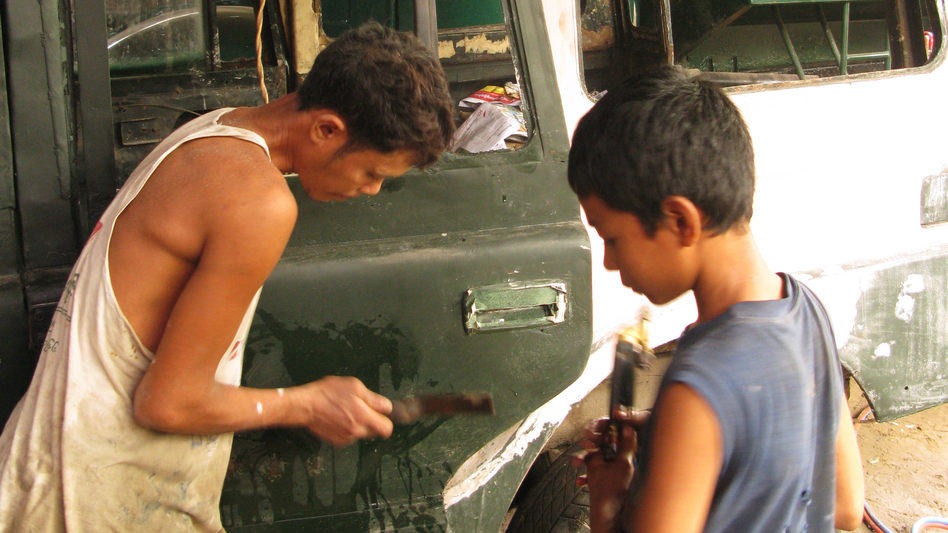 Mechanics at Ohn Myint's car repair shop on the outskirts of Yangon refurbish rusty, decades-old government jeeps. (NPR)