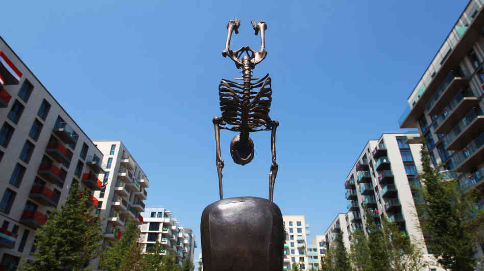 This sculpture of a skeletal gymnast stands in London's Olympic Village, where athletes are preparing for today's Opening Ceremony.