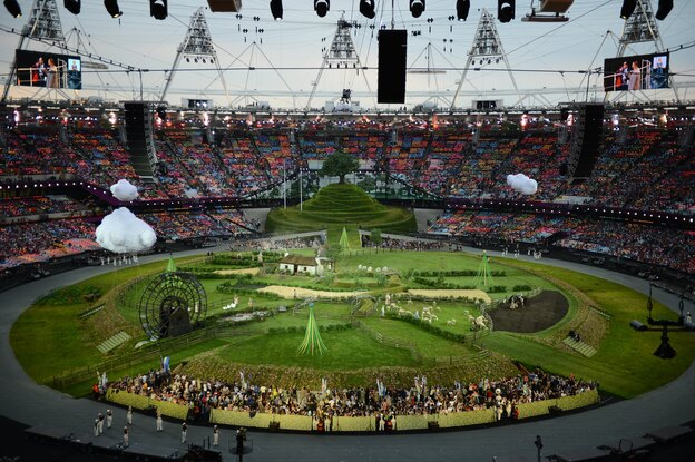 Animals and actors enter the stadium for a British meadow scene. (AFP/Getty Images)