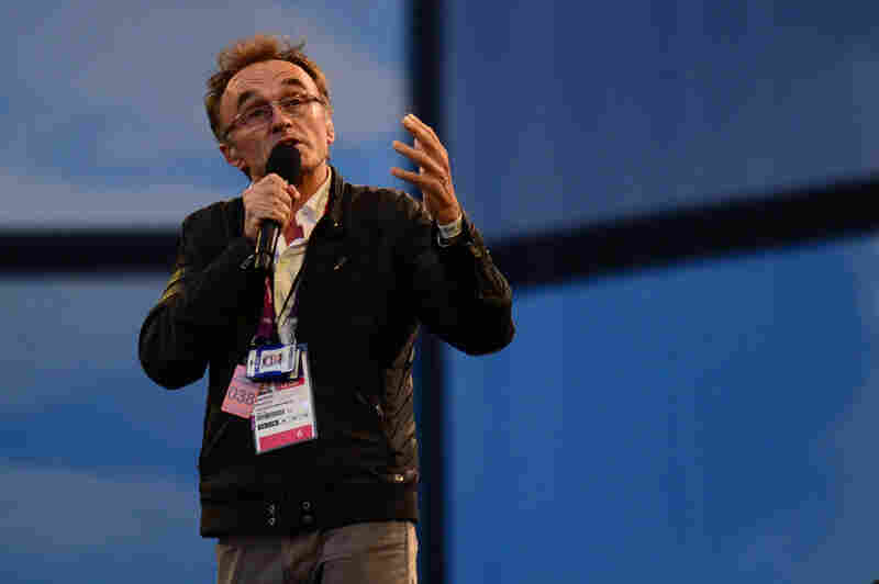 British film director Danny Boyle talks before the ceremony, which he masterminded. The show celebrates British culture, music and literature.