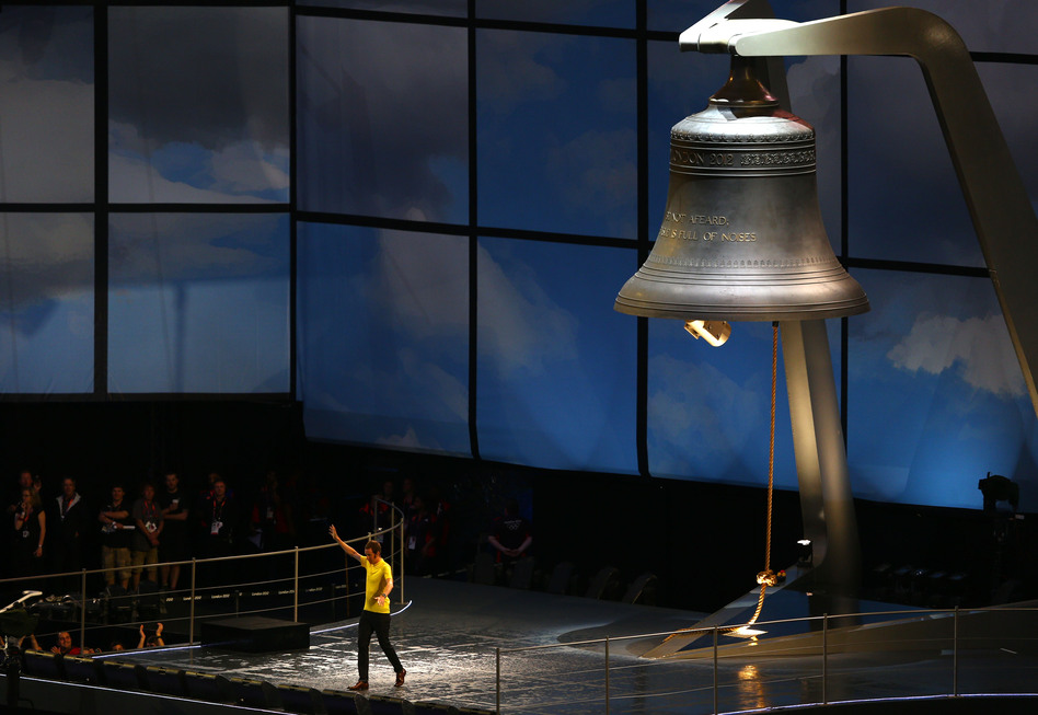 Britain's Bradley Wiggins, who won the Tour de France this year, rings the 23-ton Olympic bell, which was manufactured by the same company that made Big Ben. (Getty Images)