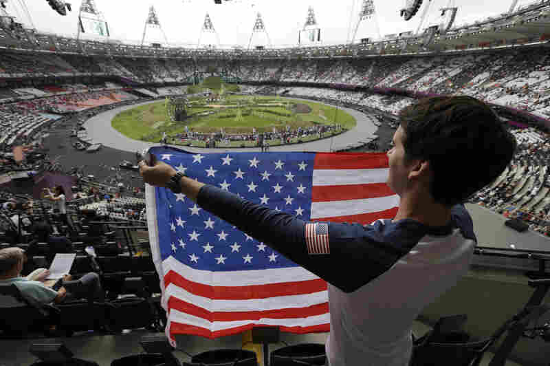 Ryan Musgrave of Chicago holds a U.S. flag.